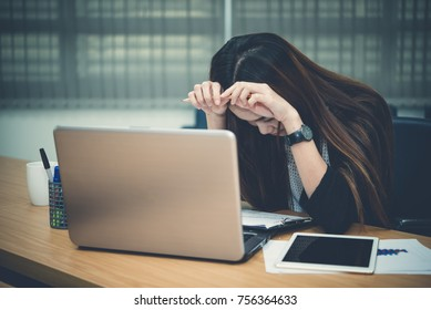 Asian businesswoman stress from hard work,Thai worker woman working in the office,Dark tone