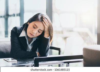asian businesswoman  stressful and headache with problem and question from project  work in meeting table office background
