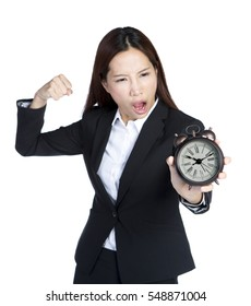 asian businesswoman trying to punch an alarm clock, isolated white background