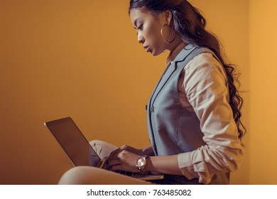 asian businesswoman using laptop with blank screen