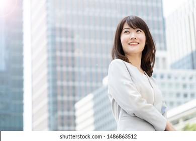 asian businesswoman walking in city