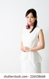 asian businesswoman wearing white one piece dress on white background
