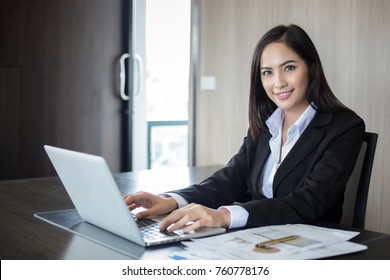Asian businesswomen and group using notebook for business partners discussing documents and ideas at meeting and business women smiling happy for working