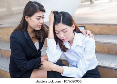 Asian Businesswomen was sick. Colleagues take care. Concern and worry of friend. Mental health, PTSD and suicide prevention. Post-traumatic stress disorder.