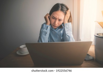 Asian businesswomen working with stress on laptops indoors, work from home.