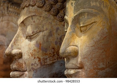 Asian carved stone faces with a serene expression