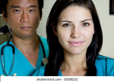 An asian and caucasian doctor team working