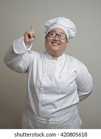 Asian chef looking up over clear background