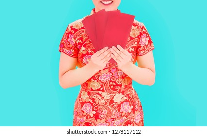 Asian cheongsam Qipao Chinese Traditional dress costume with red paper envelop call Angpoa on blue isolated background pop art colour theme in China New year festival. (include clipping path)