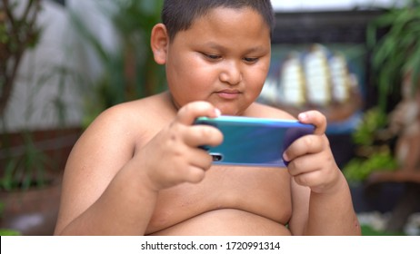 Asian child Boy are addictive playing mobile phones