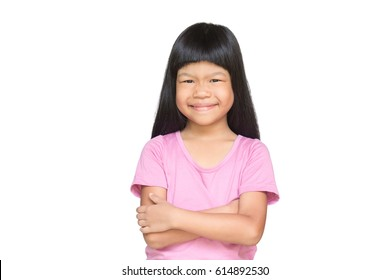 Asian child cute cross one's arm and smiling on white background, isolated