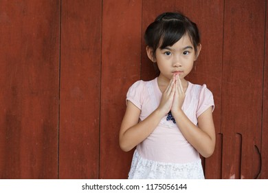 Asian child cute girl Hello salute