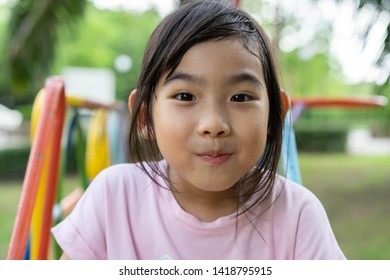 Asian child cute girl Play Playground happy smile
