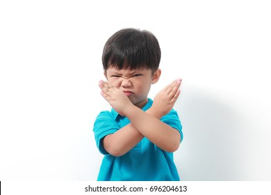 Asian child doing NO and STOP gesture. Negative human emotion, facial expression, sign, gesture, body language.