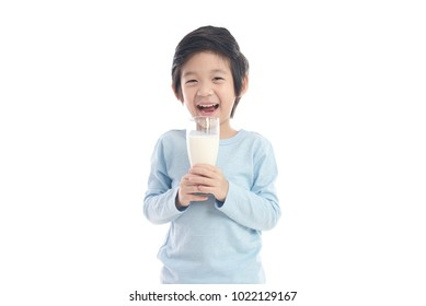 Asian child drinking milk from a glass on white background isolated