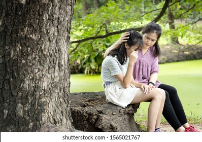 Asian child girl crying, have so many problems in her life, about school friends, sad daughter feel so relieved after talking something with her mother to vent her feelings, counselling for teenager