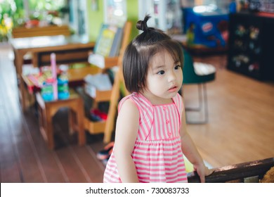 asian child girl is listening to the teacher.