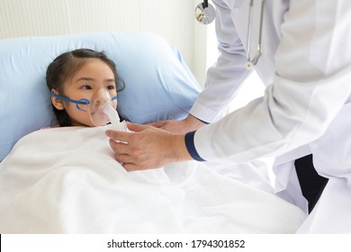asian child girl patient receiving artificial ventilation from doctor in hospital