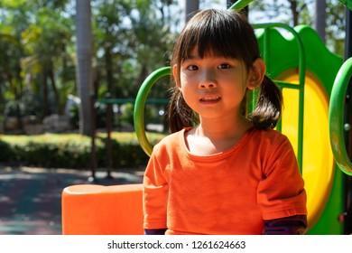 Asian child girl Play Playground