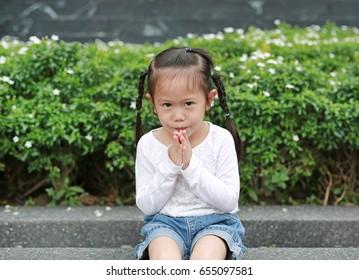 Asian child girl praying