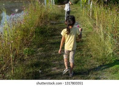 Asian child girl Running in the garden