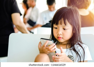Asian child girls are addictive playing mobile phones, Game Addiction