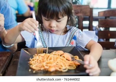 Asian Child Happy Eating Spaghetti