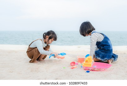 Asian Child Happy Play On The Beach