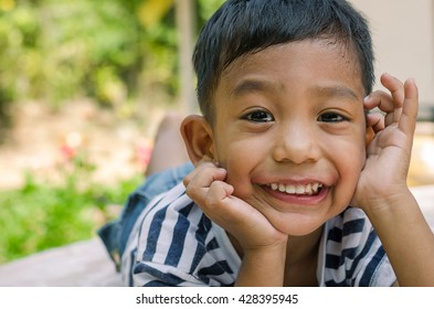 Asian Child with Happy Smile.