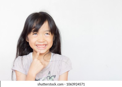 asian child look upper and smile happily to show that she think something the make she happy