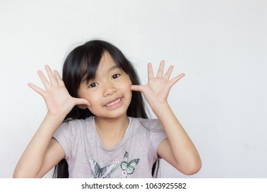 asian child play peekaboo on white background