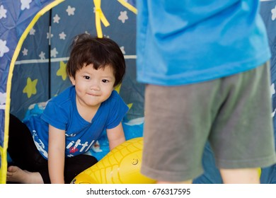 asian child playing in tent