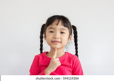 asian child point at her chin