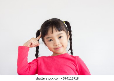 asian child point at her head