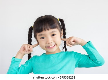 asian child point at the part of body, she point at her ears