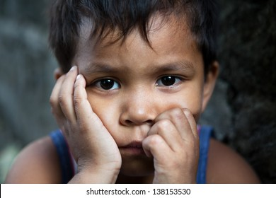 Asian child portrait - Filipino boy from impoverished area looking into camera