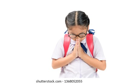 asian child in school uniform and backpack with traditional greeting of Thailand on white background isolated, Sawasdee concept