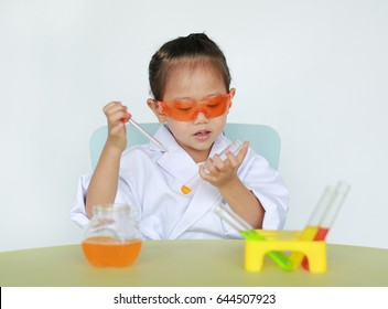 Asian child in scientist uniform holding test tube with liquid isolated on white background, Scientist chemistry and science education concept.