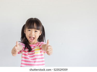 asian child show her thumbs to cheer up with happily