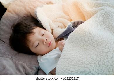 Asian child sleep on bed