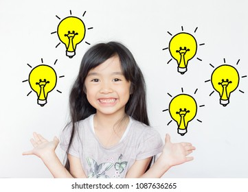 asian child smile happily with light bulbs graphic on white background