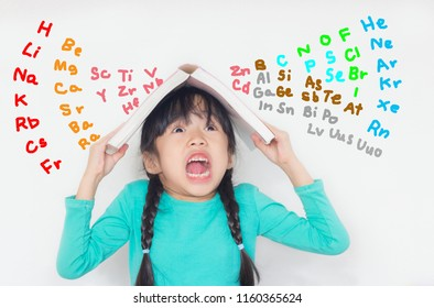 asian child take a book on her head and scream with the periodic table on white background
