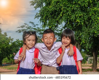 Asian children brother and two sisters in uniform of school (The letter on the shirt is the name)