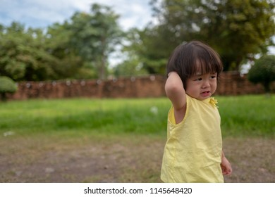 Asian children are disappointed in the park.