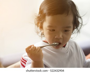 Asian children girl enjoy eating my self.