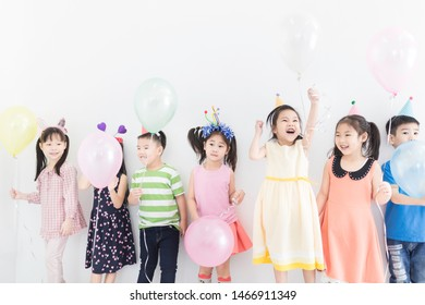 asian children group playing helium balloon in recreation party, they feeling happy and cheerful, celebration and congratulation party