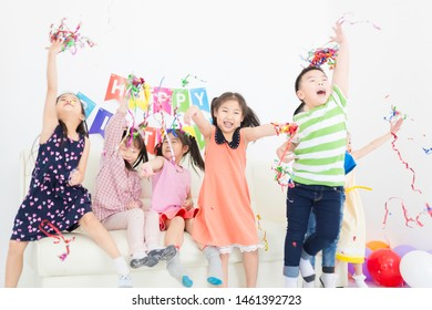 asian children group playing ribbon in birthday party, they feeling happy and cheerful, celebration and congratulation party