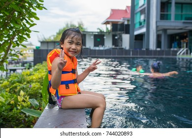 asian children happy smiling face in sport water pool