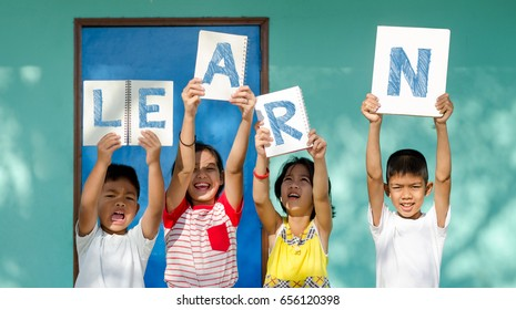 Asian Children Holding Book Signs.