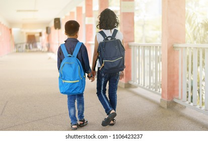 asian children holding hand together going to the school.education and people concept.back to school